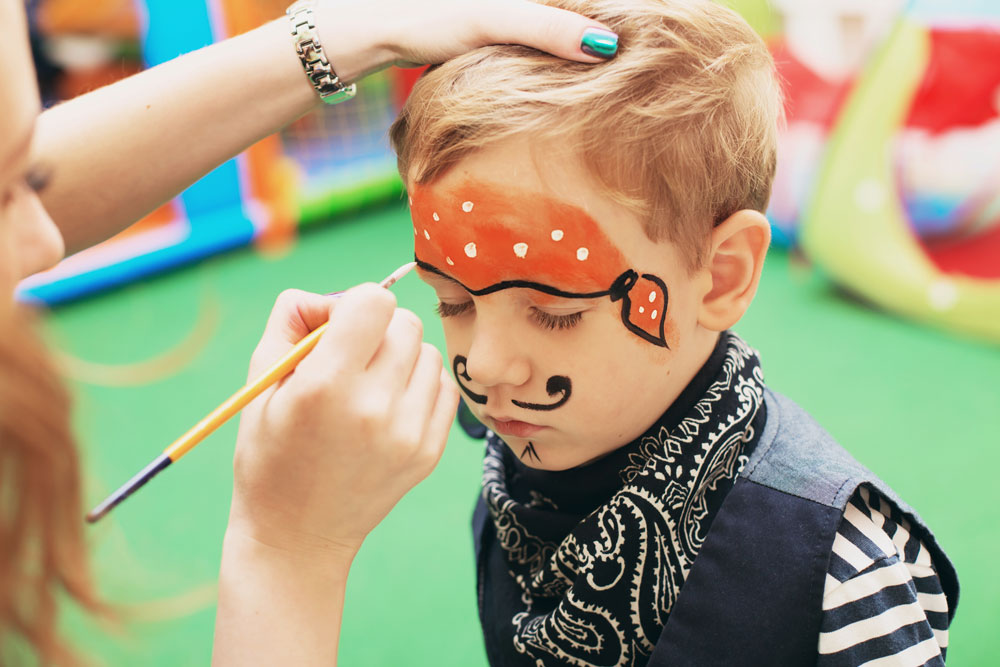 the body shop face painting - boy gets pirate make up