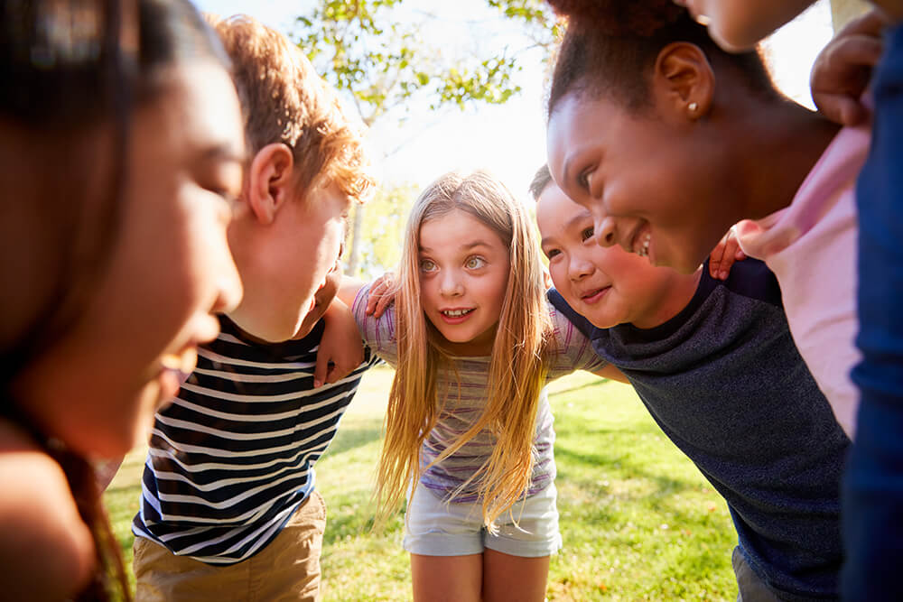 children in a huddle - youth groups