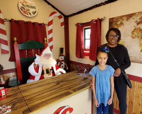 young girl and mom visiting santa