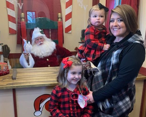 mom and daughters with santa